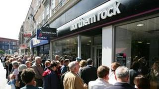 SEPTEMBER 15 2007: Customers of Northern Rock queue outside the Kingston branch