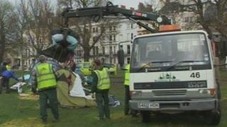 Council workers clearing away the Occupy Brighton camp