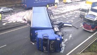 Overturned lorry and crashed car on A1(M)