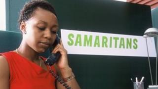 Samaritans volunteer on the phone