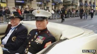 Sgt Dakota Meyer, a Medal of Honor recipient, rides in the the Veterans Day Parade in New York, 11 November 2011