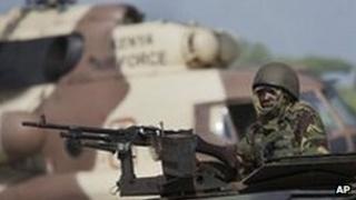 A Kenyan soldier on an armoured vehicle at their base near the Bur Garbo, Somalia, 14 Dec 2011