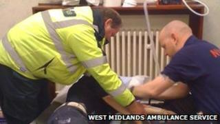 Man being treated by paramedics