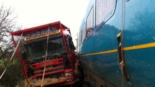 The lorry alongside the train