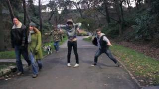 Lewis Bullock and Luke Bonner dance in park