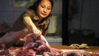 Vendor selling pork in China