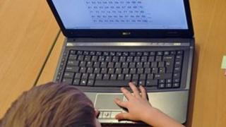 Child uses a computer at school