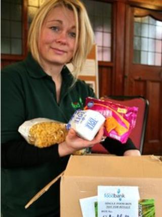 A North Lakes Foodbank volunteer packs a box