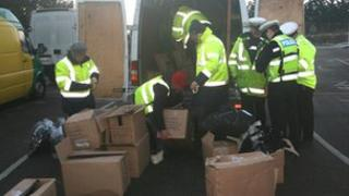 Essex Police seizing boxes near North Weald
