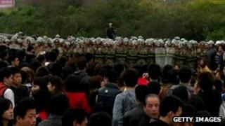 Chinese residents confront riot police as they protest along a highway to demand the coal-fired plant be moved in Haimen township, in south China's Guangdong province on December 20, 2011.