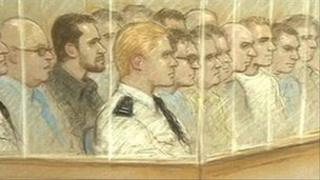 Artist's impression of the defendants and prison officers in the dock