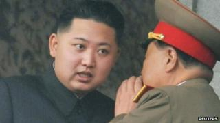 Kim Jong-un (left), the youngest son of late North Korean leader Kim Jong-il, with an official during the 65th anniversary of the founding of the Workers' Party of Korea in Pyongyang on 10 October 2010