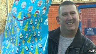Mark Gornall with Christmas presents