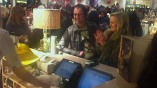 A customers claps at her purchase in Selfridges in the Bullring