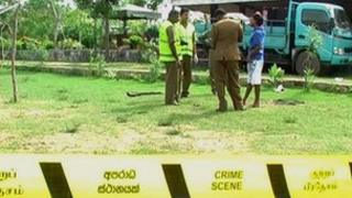 Police examine the resort at Tangalle