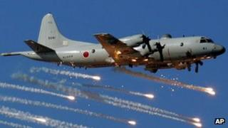 File image of a Japanese anti-submarine patrol plane firing flares during a fleet review exercise in Sagami Bay on 25 October 2006