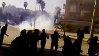 Unverified video image said to show violence at a protest in Hama on Thursday