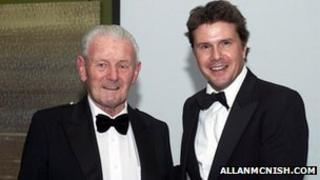 David Leslie Snr received the Stewart Medal from Mark Stewart at the Scottish Motor Racing Club Annual Dinner (image courtesy of allanmcnish.com)