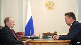 Russian Prime Minister Vladimir Putin (left) and Gazprom CEO Alexei Miller at Mr Putin's residence outside Moscow, 30 December 2011