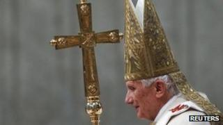 Pope Benedict XVI arrives to lead a mass at Saint Peter's Basilica at the Vatican, 1 January 2012