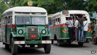 File images of buses in Rangoon, Burma, in July 2008