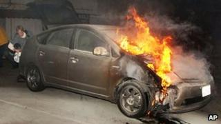 Car on fire in a car park in Los Angeles on 2 January 2012