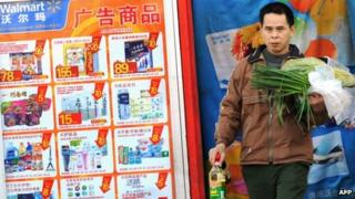 A Chinese shopper leaves a Walmart store in Beijing