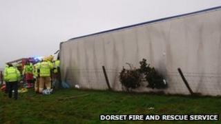 Fire crews cut a driver free from a lorry on A37 following severe weather