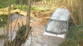 A driver had to be rescued from a car which was swept down a ford in Chew Stoke which was swollen by heavy rain