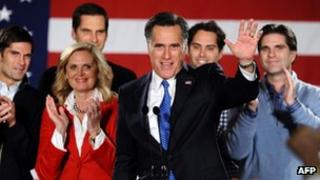 Republican presidential candidate Mitt Romney with his family behind him during his caucus night rally in Des Moines, Iowa, on Tuesday