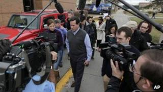 Republican presidential candidate, former Pennsylvania Sen. Rick Santorum is surrounded by news media following a campaign appearance at the Indianola Public Library Saturday, Dec. 31, 2011, in Indianola, Iowa.