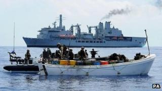 Royal Marines searching a whaler boat about 350 nautical miles from the Somali coast which was suspected of piracy