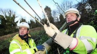 NIE repair teams work to restore electricity supplies following the storm