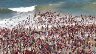 Several thousands of New Year party revellers and holidaymakers gather on the North Pier Beach and the swimming pool during New year festivities in Durban on 1 January 2012