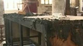 The charred altar at St Mary the Virgin in Carisbrooke