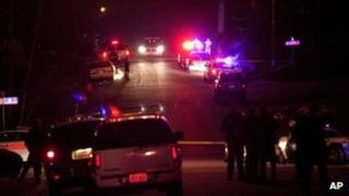 Police cars and emergency services on Jackson Avenue in Ogden, Utah after a police shootout 5 January 2012