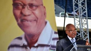 """South African President Jacob Zuma addresses the crowd during a celebration of the 50th anniversary of the African National Congress"""" (ANC) former armed wing Umkhonto WeSizwe (MK) at the Orlando Stadium in Soweto on December 16, 2011."""