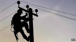 Subcontractor for Scottish Power repairs an overhead line near Auchenbowie in Scotland