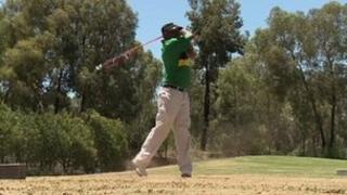 Member of ANC elite plays golf during ANC centenary festivities at Bloemfontein in South Africa on Friday