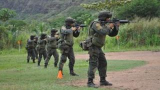 Members of the Jungla team training on a shooting range in Colombia