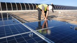 Solar panels being fitted to the roof of Dursley Pool in Gloucestershire