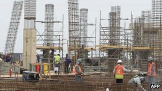 Workers at the ongoing construction of the Acu support belonging to the EBX Group of Brazilian billionaire Eike Batista,north of Rio de Janeiro