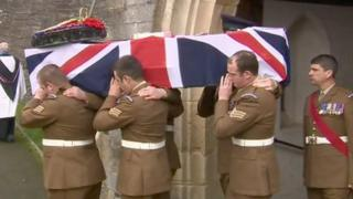 The coffin L/Sgt Dan Collins is carried from the church