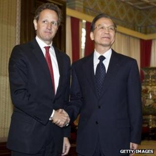 US Treasury Secretary Timothy Geithner (L) shakes hands with Chinese Premier Wen Jiabao ahead of a meeting in Beijing, 11 January 2012