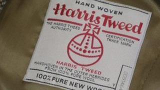 Harris Tweed orb symbol inside tweed jacket