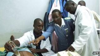 Malawian medical staff treat a patient