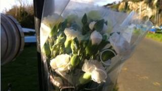 A floral tribute at the scene of the fatal crash