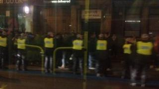 Police lined up in Whitechapel Road