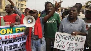 A young man shouts slogans at a protest in Lagos, Nigeria