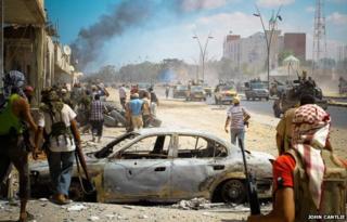 Rebel gun trucks in Sirte, Libya, in September 2011 - photo by John Cantlie